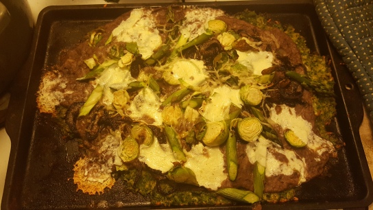 Broccoli Crust Pizza with Black Bean Garlic Puree, Caramelized Red Onion, Asparagus, Brussels Sprouts and Fresh Mozz